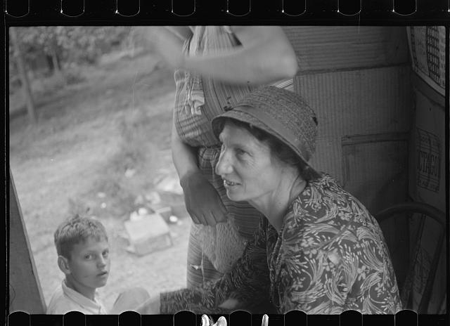 Farm woman in conversation with relief investigator, West Virginia