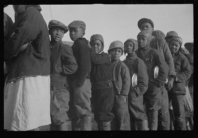 [Untitled photo, possibly related to: Negroes in the lineup for food at the flood refugee camp, Forrest City, Arkansas]