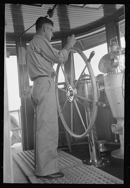 Captain of tugboat at the wheel, lower Mississippi River