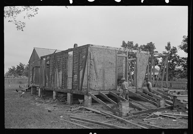 [Untitled photo, possibly related to: Side wall of old house dating from early nineteenth century showing details of construction. Showing use of mud and moss as filling agent. Near Edgard, Louisiana]