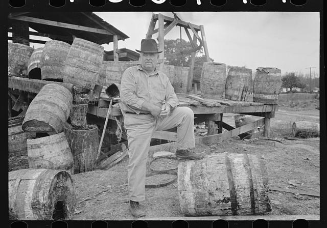 Owner in front of his turpentine still, State Line, Mississippi