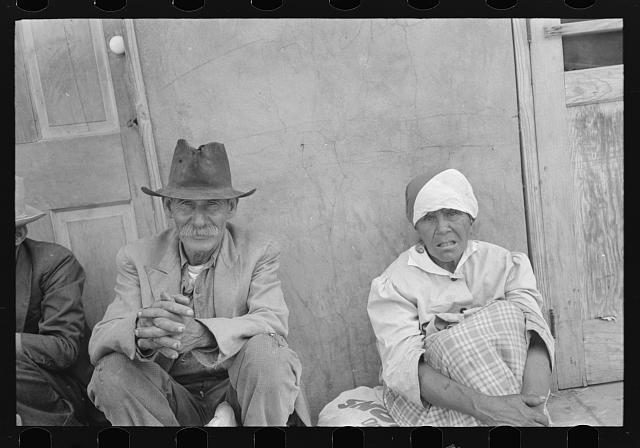 Mexican man and woman waiting for relief commodities, San Antonio, Texas
