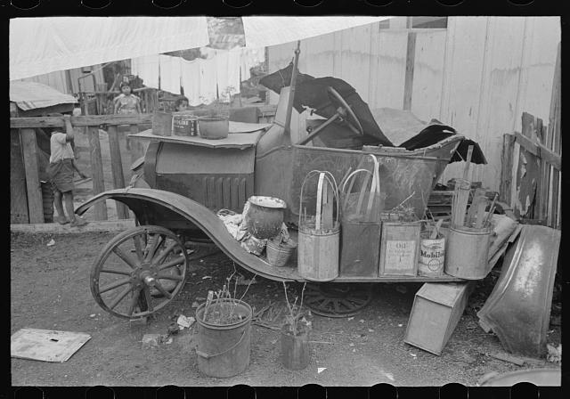Old automobile with various potted flowers, Mexican district, San Antonio, Texas