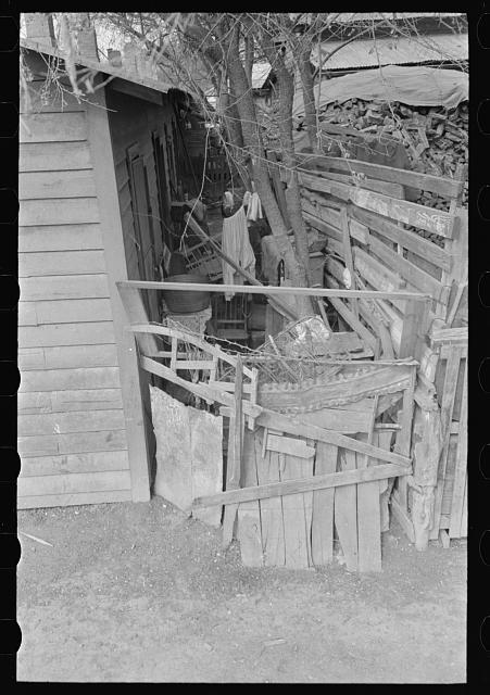 [Untitled photo, possibly related to: Alleyway leading to corral in Mexican district, San Antonio, Texas. Ten or more houses are built around the corrals which are used as community yards]