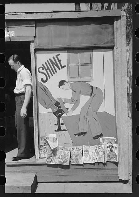 Sign on side of shoe shine parlor, San Antonio, Texas