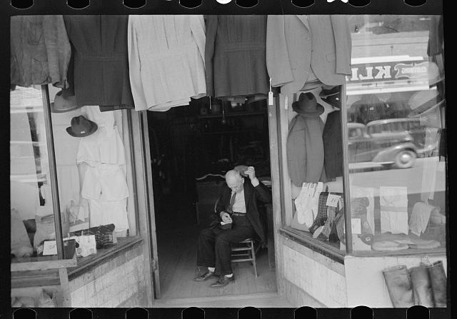 [Untitled photo, possibly related to: Mexicans looking at suits for sale, San Antonio, Texas]