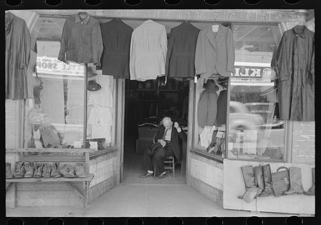 Clothing store with tailor in doorway, Mexican district, San Antonio, Texas