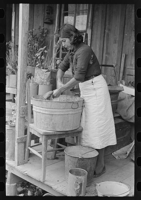 Mexican woman washing clothes, San Antonio, Texas
