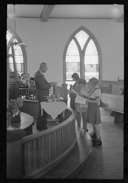 [Untitled photo, possibly related to: Preacher reading the lesson and instructions before baptism, San Augustine, Texas]