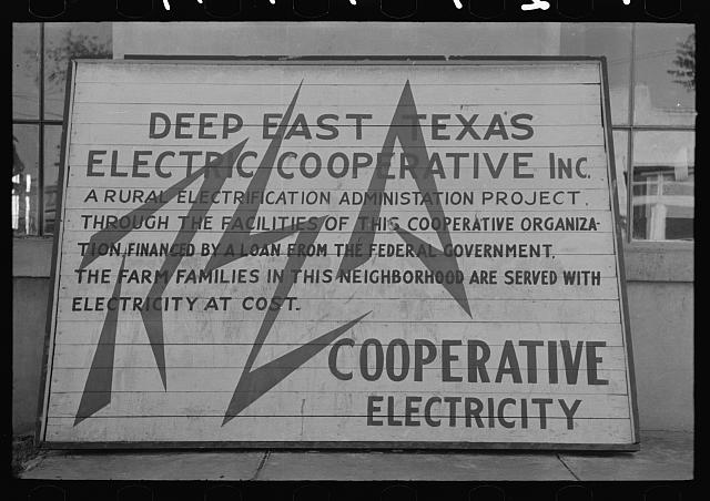 Sign illustrating electric cooperative, San Augustine, Texas