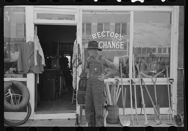 Man in front of secondhand store, Muskogee, Oklahoma