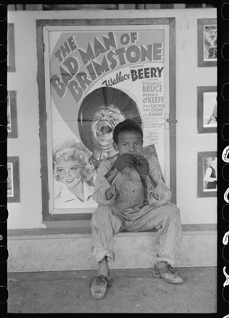 [Untitled photo, possibly related to: Man in front of movie theater, Waco, Texas]