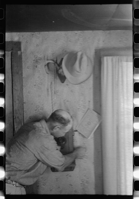 [Untitled photo, possibly related to: West Texas ranchman making a telephone call, Kimble County, Texas]