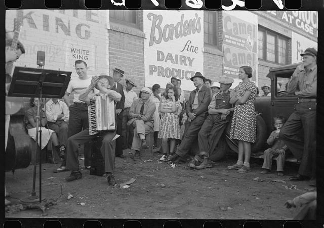 [Untitled photo, possibly related to: Orchestra playing outside a grocery store on Saturday afternoon which is designed to attract customers to the store, Phoenix, Arizona]