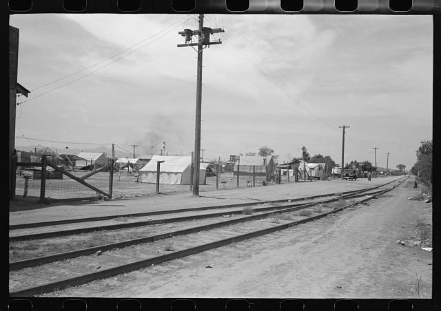 Tents used for dwellings near the railroad tracks in Phoenix, Arizona