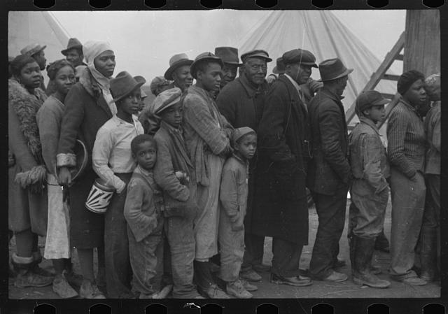 [Untitled photo, possibly related to: Flood refugees at mealtime, Forrest City, Arkansas]