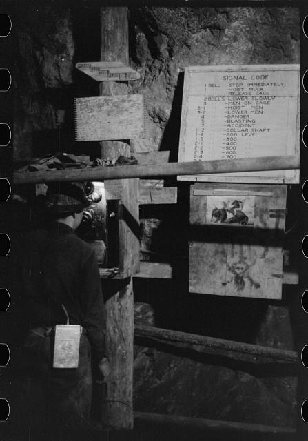 Miner using telephone at 500-foot level at gold mine. Mogollon, New Mexico