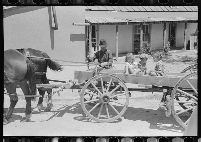 Spanish-American farmer and family arriving at Penasco, New Mexico for shopping