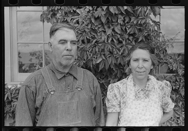 Spanish-American farmer and his wife, Chamisal, New Mexico