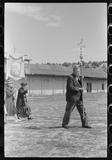 Spanish-American man leading the Catholic procession held in honor of a saint. Penasco, New Mexico