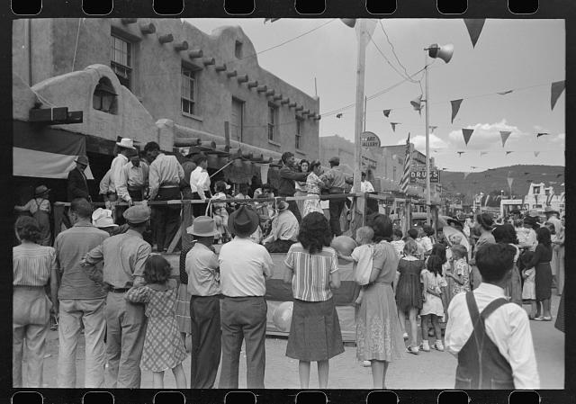 Crowd watching native Spanish-American dances at fiesta, Taos, New Mexico