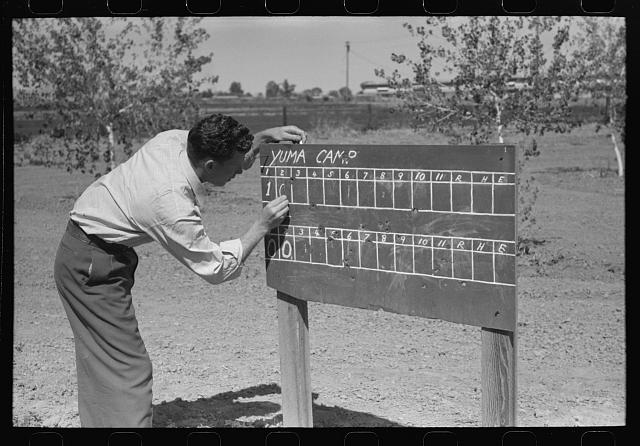Scoreboard for baseball game at the annual field day of the FSA (Farm Security Administration) farmworkers community, Yuma, Arizona