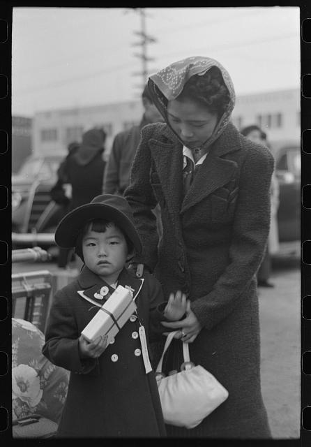 [Untitled photo, possibly related to: Los Angeles, California. The evacuation of the Japanese-Americans from West Coast areas under U.S. Army war emergency order. Waiting at the old Santa Fe station for the train which will take them to Owens Valley]