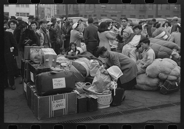 [Untitled photo, possibly related to: Los Angeles, California. The evacuation of the Japanese-Americans from West Coast areas under U.S. Army war emergency order. Evacuees waiting with their luggage at the old Santa Fe station for a train to take them to Owens Valley]