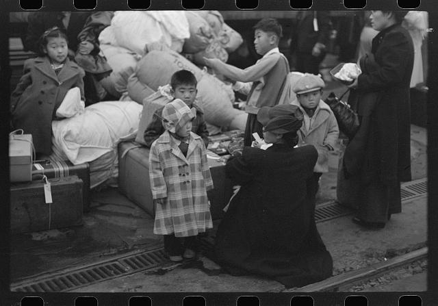 Los Angeles, California. The evacuation of the Japanese-Americans from West Coast areas under U.S. Army war emergency order. Evacuees waiting with their luggage at the old Santa Fe station for a train to take them to Owens Valley