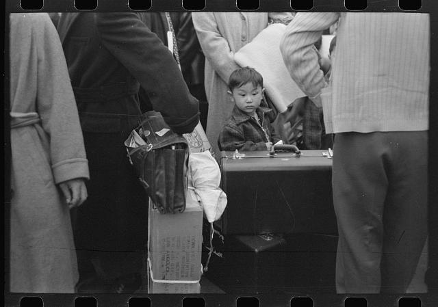 Los Angeles, California. Japanese-American evacuation from West Coast areas under U.S. Army war emergency order. Waiting for the train to take them to Owens Valley