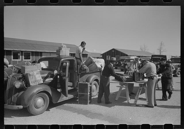 Santa Anita reception center, Los Angeles County, California. Baggage of Japanese-Americans being inspected as they arrive from West Coast areas under U.S. Army war emergency order
