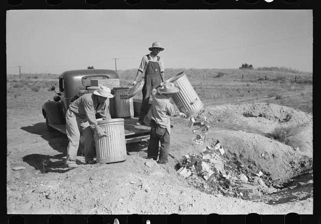 Nyssa, Oregon. FSA (Farm Security Administration) mobile camp. Japanese-Americans dumping garbage. All occupants of the camp spend two hours a week in maintenance work