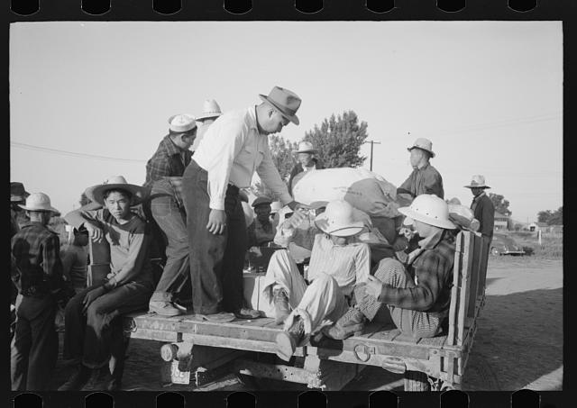 Nyssa, Oregon. FSA (Farm Security Administration) mobile camp. Japanese-American farm workers leaving the camp