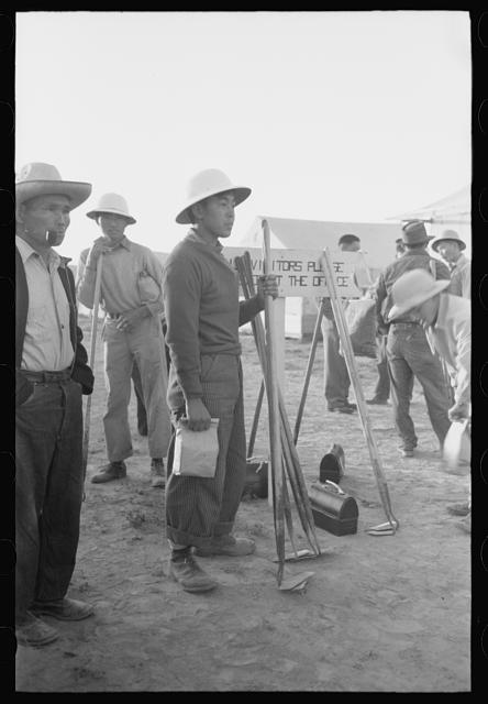 Nyssa, Oregon. FSA (Farm Security Administration) mobile camp. Japanese-American farm workers ready to leave for the fields. The farmers send trucks to the camp to pick them up