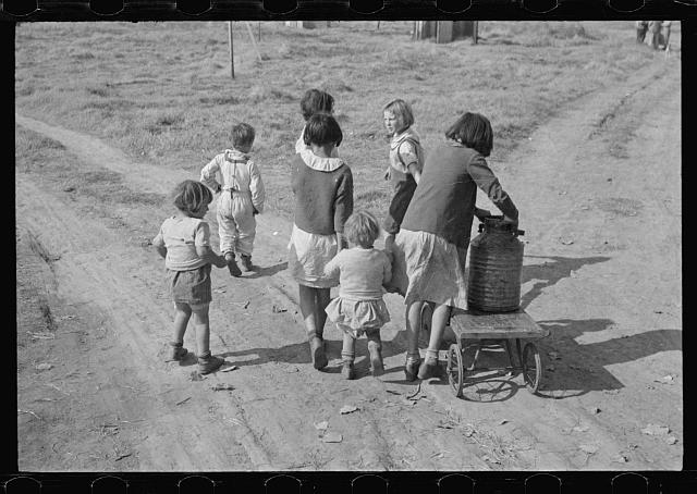Children of migratory workers, hauling water, American River camp, San Joaquin Valley, California