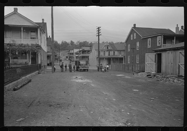 Shenandoah(?), Pennsylvania. An alley in the more prosperous section of the town where some boys and men are gathered about a truck