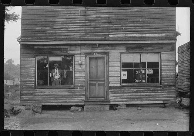 A combination pool room, barbershop, shoe shine parlor and general hangout for Negroes in Roxboro, North Carolina
