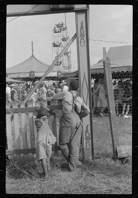 At the Greene County fair, Greensboro, Georgia. White schoolchildren were admitted free one day, Negro schoolchildren the next