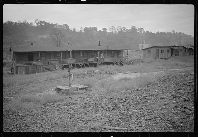 Coal miners' shanties by the river, West Virginia