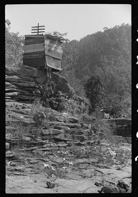 Privy used by Negroes living in shacks on highway between Charleston and Gaauley Bridge, West Virginia