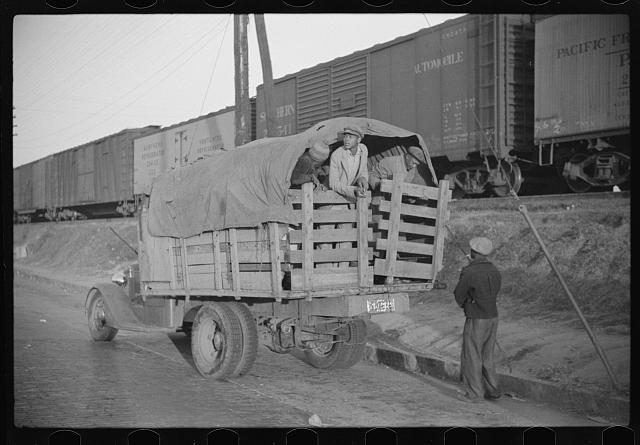 [Untitled photo, possibly related to: Day laborers being hired for cotton picking on Mississippi and Arkansas plantations. Between four and six-thirty every morning during the season, near the Hallan Bridge in Memphis, Tennessee, crowds of Negroes in the streets gather and are loaded into trucks by drivers who bid, and offer them anywhere from fifty cents to one dollar per day]