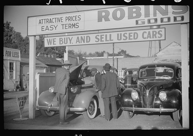 Used car lot, Clarksdale, Mississippi Delta, Mississippi. Big sales go on after cotton picking season to get the money cotton pickers have made. Many of the pickers buy new or used cars with their cotton money