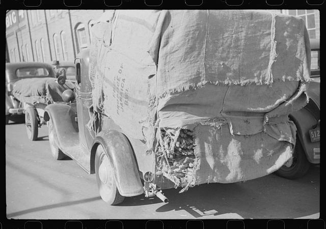 Farmers put their tobacco in the handiest conveyance to bring to tobacco warehouse for auction. Durham, North Carolina