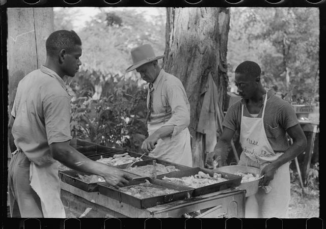 [Untitled photo, possibly related to: Cooking fried supper for a benefit picnic supper on the grounds of St. Thomas' Church. Near Bardstown, Kentucky]