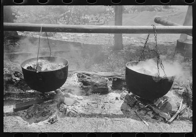 Barbecuing beef and lamb for a benefit picnic supper on the grounds of St. Thomas' Church. Near Bardstown, Kentucky