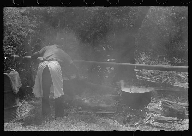 [Untitled photo, possibly related to: Barbecuing beef and lamb for a benefit picnic supper on the grounds of St. Thomas' Church. Near Bardstown, Kentucky]