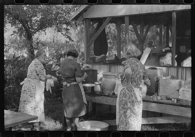 Parishoners preparing food for a benefit picnic supper on the grounds of St. Thomas Church. Near Bardstown, Kentucky