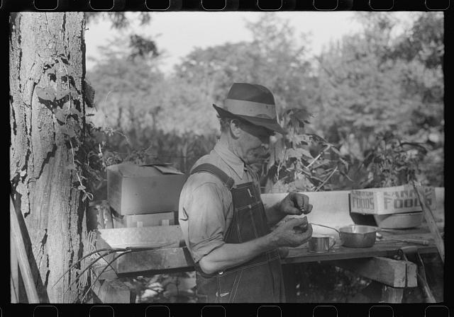 [Untitled photo, possibly related to: Picnicker peeling apple at St. Thomas church supper, near Bardstown, Kentucky]