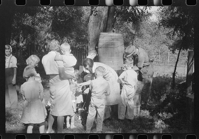 [Untitled photo, possibly related to: Parishoners gossiping while waiting for picnic supper at St. Thomas Church Picnic near Bardstown, Kentucky]