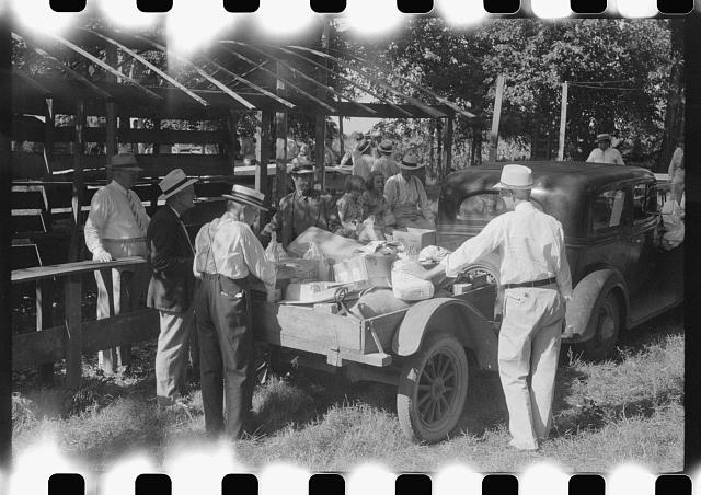 [Untitled photo, possibly related to: Unpacking supplies at the St. Thomas Church picnic supper near Bardstown, Kentucky]